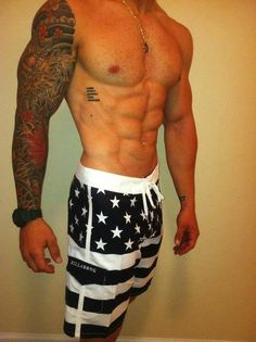 #tattoos #ink #muscle #abs #boardshorts