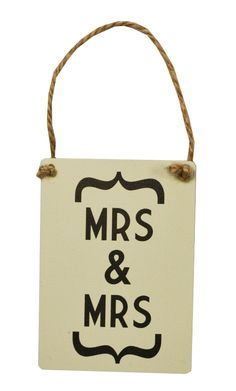 Mini Metal Sign – 'Mrs & Mrs' Vintage style mini metal hanging metal sign reading 'Mrs & Mrs'.  The perfect wedding decoration or gif for the happy couple.  Size – approx. 9x6.5cm