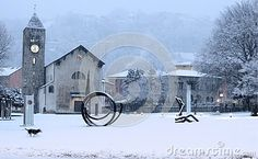 A snowing landscape of the church of Giubiasco, a city in Canton Ticino, in…