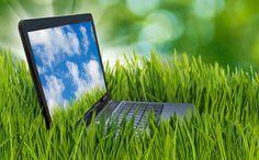 Image of laptop in the grass.