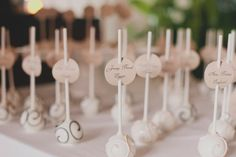 cake pops that double as seating cards for guests.