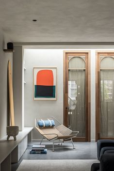 """The meranti wood and glass doors are over nine feet tall, and have a custom arch detail at the top. The clay coating on the walls and ceiling are by Matteo Brioni. """"We mixed some colors together to give the space a perfect warm and serene feel,"""" says Valérie. """"We added the same clay finish to the ceiling and the walls to create a sense of intimacy."""" #dwell #garagemakeovers #garageconversions #moderndesign Garage Interior, Home Interior, Living Area, Living Spaces, Living Rooms, Garage Transformation, Basement Flat, Glass Partition Wall, Ideas Hogar"""
