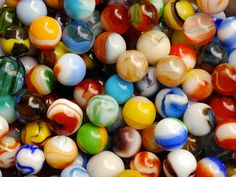 In 1848, a German glass blower invented marble scissors, a spherical mold that revolutionized the process of making marbles. This pic is of machine made marbles.