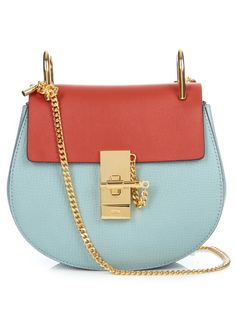 Chloé's Drew bags are loved for their distinctive horseshoe shape and 1970s sensibility. This style arrives in sky-blue grained lamb leather with a rust-red smooth-leather front flap, and signature gold-tone bar-clasp fastening. The colours will beautifully offset the label's dreamy white lace dresses.