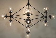 Small Mickey Metal and Glass Chandelier Uses 13 Type B Bulbs, 60W Maximum Includes 6 of Chain and Cord and Large Canopy with Dark Finish, Additional Chain Available To Order Also Available in Larger Size