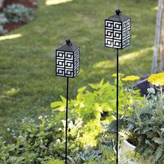 """Solar Garden Stake -  add to the garden, to a potted plant or use without stake as a tabletop piece or hang. Solar-charged light lasts six to eight hours. Includes rechargeable AA battery. Weather-resistant. When used as stake: 36¼""""h. Lantern only: 6""""h, 3""""square."""
