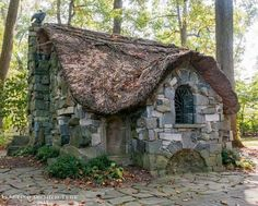 Little stone cottage (apparently the fairy cottage at winterthur)! Love the funky roof shape and the tree in the window! Little stone cottage (apparently the fairy cottage at winterthur)! Love the funky roof shape and the tree in the window! Witch Cottage, Cute Cottage, Cottage Style, Witch House, Stone Cottages, Cabins And Cottages, Stone Houses, Fairytale Cottage, Garden Cottage