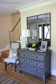 Love the long mirror over the long console entries for Small foyer cabinet