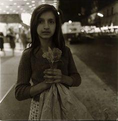 Diane Arbus Child Selling Plastic Orchids at Night, New York City 1963