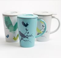 """the perfect tea mug""  pretty mugs with birds on them, that come with a stainless steel infuser and lids."