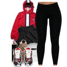 Red windbreaker, black top, black leggings, red and black Adidas flux.