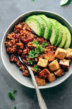 ENCHILADA POWER BOWLS WITH SPICY TOFU. 18 Vegetarian Bowls That Make Breakfast, Lunch and Dinner a Breeze #purewow #vegetable #salad #food #veggiebowl #vegetarianbowls #vegetarianlunches #vegetariandinners #spicytofu #enchiladas