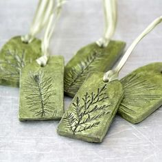 Ceramic Ornaments with Natural Plant Impression Christmas Holiday Decoration – Set of 5 —————————————————————————— I have hand-sculpted these nature inspired clay ornaments from white clay and impressed real evergreen plant twigs Ceramic Jewelry, Polymer Clay Jewelry, Cerámica Ideas, Decor Ideas, Gift Ideas, Polymer Clay Christmas, Polymer Clay Ornaments, Paperclay, Dry Clay
