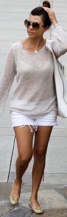 Kourtney Kardashian: Purse and sunglasses – Tom Ford  Shoes – Balenciaga