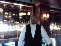 Cleveland Bartending School instructor Milton W., mixing it up behind the bar. — at Cedar Creek Grille.