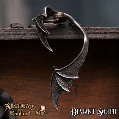 Best Seller! Alchemy Gothic E376 A Night With Goethe Stud Ear-Wrap (left)  A black pewter bat's wings wrapping around the ear - can be gently squeezed to comfortably fit your own ear; fastened at the lobe with one surgical steel ear-post.
