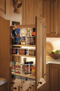 Making the most of a slim space, the Base Pantry Pull Out cabinet is perfect for point of use storage of spices, oils and other kitchen necessities.