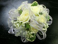 A white on white prom corsage creates elegant simplicity. #promflowersrowlett #2floristgirls