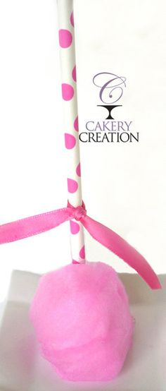 Cotton Candy Cake pops by Cakery Creation in Daytona Beach. Cotton candy flavored cake pop wrapped in real cotton candy