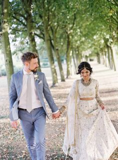 This couple planned a multicultural wedding paying homage to the both groom's English and the bride's Indian heritage all set at a countryside estate outside of London.