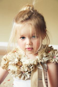 I was searching crafts and came across this picture and couldnt help but see how much this girl looks like Bella!