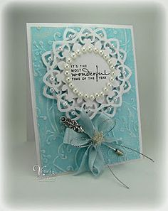 Wow!  To create this card I cut out the largest circle Nestability and then the next size down. Ipunched each one with the Martha Stewart French Scroll corner punch  by Andrea Ewen