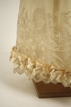Hem detail c1820 silk dress. Met museum