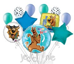 """Included in this bouquet: 11 Balloons Total 1 – 31"""" """"Roo-Hoo!"""" Scooby-Doo Round Balloon 1 – 18"""" Heads & Tails Scooby-Doo Round Balloon 1 – 18"""" """"Scooby-Doo"""" Square Balloon 1 – 18"""" Blue Star Balloon 1 –"""