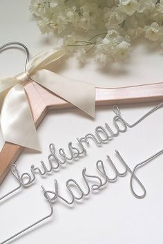 "A unique custom wedding hanger hanger for your bridesmaids! We will put the word ""bridesmaid"" on the top tier, and the bridesmaid's first name on the bottom for you. *ALL orders now ship for free unti"