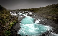 Download wallpapers mountain river, glacial river, stones, coast, cloudy weather, Arnessysla, Iceland, Bruarfoss