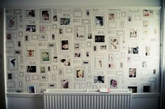 Awesome idea!  The wallpaper is called FRAMES by Taylor & Wood and IMO. Used blue tac to attach pics.