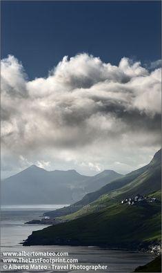 Clouds over village near Kirkjubour, Faroe Islands, North Atlantic.