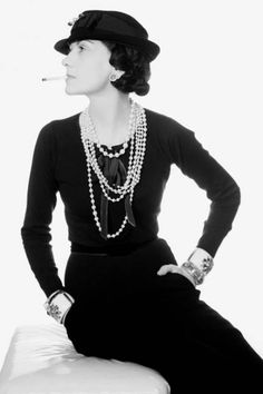 The iconic Coco Chanel wearing her signature pearls and Maltese Cross cuffs made for her by Duke Fulco di Verdura