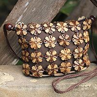 Compact and beautiful, this petite handbag is crafted by hand. Sasithon Saisuk transforms coconut shells into flowers and links them with mango wood beads. Lined in brown cotton, the purse closes with a zipper.   http://handbags.novica.com/shoulder-bags/coconut-shell-shoulder-bag-petite-garden/203554