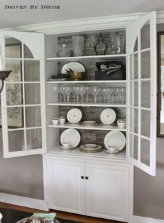 Built-in china cabinet backed in Pergo to showcase the tableware