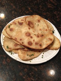homemade gluten free / dairy free / yeast free naan. tasted just like regular naan! used 1 3/4 c gf bisquik, little more than 1/2 c soy milk, 2 tsp olive oil, 2 tsp sugar, 1 tsp salt, 3/4 tsp baking powder. (modified this recipe to make it GF/DF http://www.thekitchenpaper.com/quick-naan-without-yeast/) mix the dry ingredients, make a well and add the milk & oil, knead and cover for 10 mins until ready to roll out and cook.