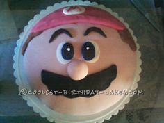 Super Easy Super Mario Cake for a Super Mario Fan... This website is the Pinterest of birthday cake ideas