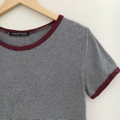 "Black and White Striped Tee Similar to the Brandy Melville tee. Black and white thin stripes. Maroon trim. Comfortable. Looser fit tee. Semi-cropped top. Fits size small best. 21.5"" long. NO TRADES OR PAYPAL. Tops Tees - Short Sleeve"