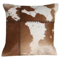 "Cowhide-inspired pillow.  Product: PillowConstruction Material: CowhideColor: Tan goldFeatures:  WhipstitchInsert included Dimensions: 16"" x 16"""
