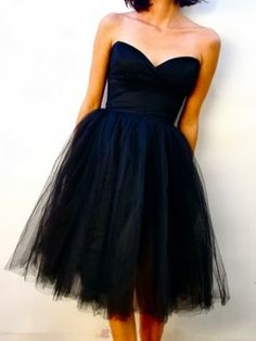 Every girl needs a little black dress... I love how feminine the tulle skirt is & the sweetheart neckline