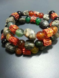 """""""Tropical Storm II"""" Wrap Bracelet One of a kind One size fits all very comfortable! Made with stainless steel memory wire and glass beads and natural stones!"""
