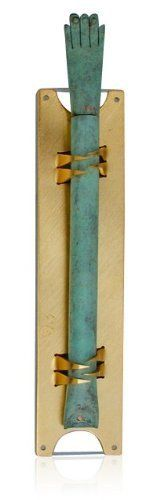 Brass and Gold Mezuzah with Hamsa Hand from Shraga Landesman by World of Judaica. $112.00. From Israeli artist Shraga Landesman comes this gold-plated brass, hamsa shaped mezuzah, which when hung in a doorway, can also be used as an amulet to ward off the evil eye. The body of the mezuzah is constructed of a gold-plated brass background with two sets of teeth that grasp the mezuzah on the top and bottom. A green hamsa hand, which is believed to protect against the evi...
