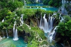 the Plitvice Lakes in Croatia.  Named by the priest Dominik Vukasovic, plitvice in Croatian means shallow basins filled with water and made by nature.  I'd also like to fly over this National Park via helicopter.  Apparently the lakes are known for having distinctive colors that range from azure to green, grey or blue!
