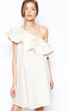 Made from pure 100% cotton. Asymmetrical design. Oversized frill detailing. All over textured design...