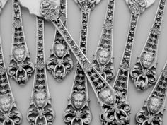 "Pattern detail from French sterling silver oyster forks with renaissance style ""mascarons"" motif, c1880"