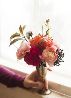 Flower arrangement - light and hot pink carnations with pale pink rose, orange-red pincushion protea and ivy berries
