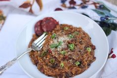 Chorizo Risotto -- the Italian classic dish is updated with the sweet smokey flavors of Ancho Chile and Chorizo sausage. Great weeknight dinner with robust comfort food flavors. #food #yummy #delicious