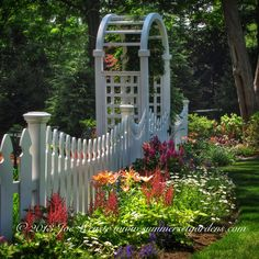 I used a small picket fence, arbor and a blend of perennials to surround a play area for the kids.