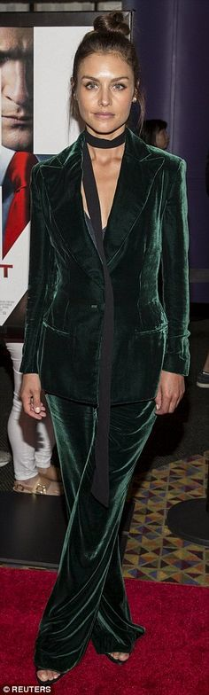 Gorgeous in green: Hannah, 32, stunned in a bottle green velvet trouser suit...