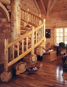 Tree-looking wood logs surrounding stairs in a log home.